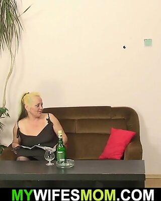 Hairy blonde mother-in-law rides cock
