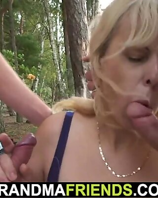 Old blonde grandma is forced into outdoor threesome
