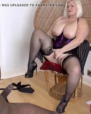 Mature Brit in lingerie sucks black shlong