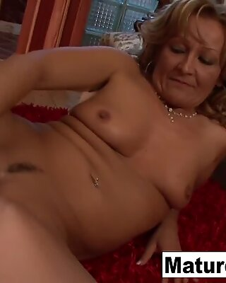 Sexy blonde granny takes a black cock in her ass