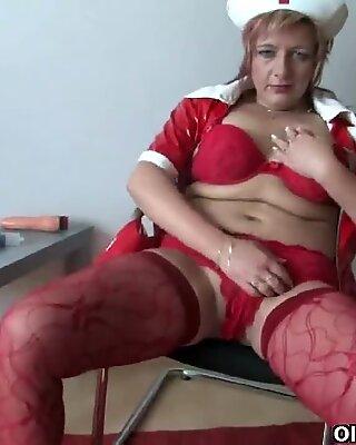 Hot older woman in nurse uniform wears stockings and heels