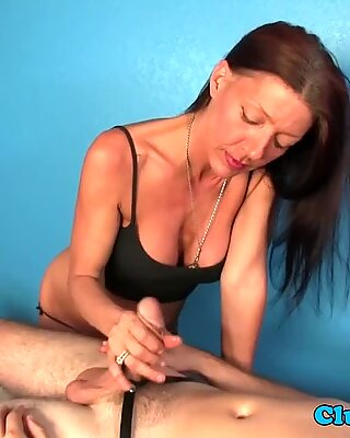MILF masseuse tugs dick with hands and tits